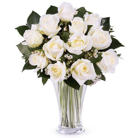 Une touche de classe : 12 roses blanches